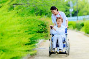 Elderly female wheelchair and caregiver