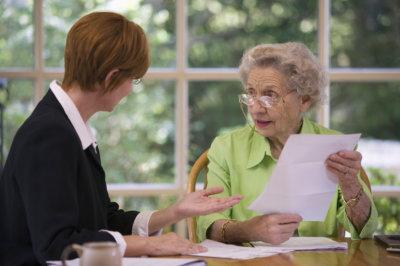 senior woman talking to consultant