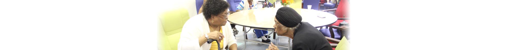 Two elderly Woman talking