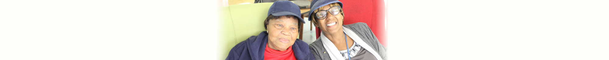 elderly woman and lady wearing eyeglasses smiling